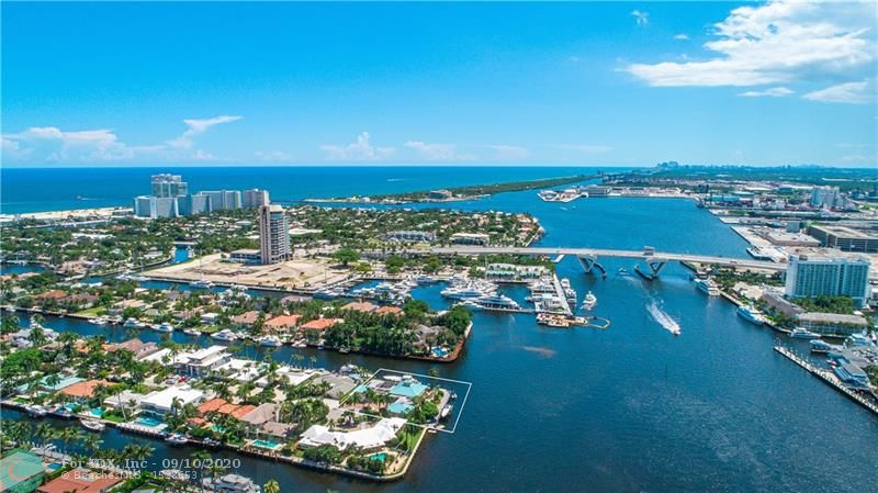 Step Into Serenity, With this Prized Point Estate, Over 290ft Multi Yacht Dockage, and Breathtaking Views.  Perfectly Situated on the Most Desirable Southwest Exposure, Offers Refreshing All-Day Sunlight, Soothing Ocean Breezes, the World's Best Sunsets that you will Appreciate Indefinitely, and a Constant Boat Parade of the Finest yachts.  Exceptional Property, Emphasizes the Spectacular Intracoastal Water Views, with 20ft Living Room Ceilings, Large Master Bedroom, Exceptional Pool, and Ample Garage & Covered Parking to Host Your Priceless Car Collection.  Schedule a Viewing Today and Move One Step Closer to Seeing Your Dream Turn Into Reality.