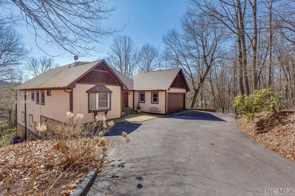 This home is located on a quiet cul-de-sac in Highlands Falls Country Club with nice mountain views from the screened-in back porch.  The home has a partially finished lower level of over 1500 square feet in area (according to the Macon County tax assessor's estimate) that could be renovated to provide a significant increase in the living area for the house. Currently, access to the lower level is from the outside but a stairwell could be installed in the main level entrance area for interior access. Beautiful sunsets can be enjoyed from the west-facing back deck. The recreational amenities available to the homeowners in Highlands Falls Community Association come through membership in the Highlands Falls Country Club. HFCC offers golf, croquet, tennis, pickleball, swimming, fine dining, and has a very active bridge game twice a week. Membership to HFCC is not required for homeownership. Application for membership to Highlands Falls CC is subject to approval by the HFCC Board of Directors.