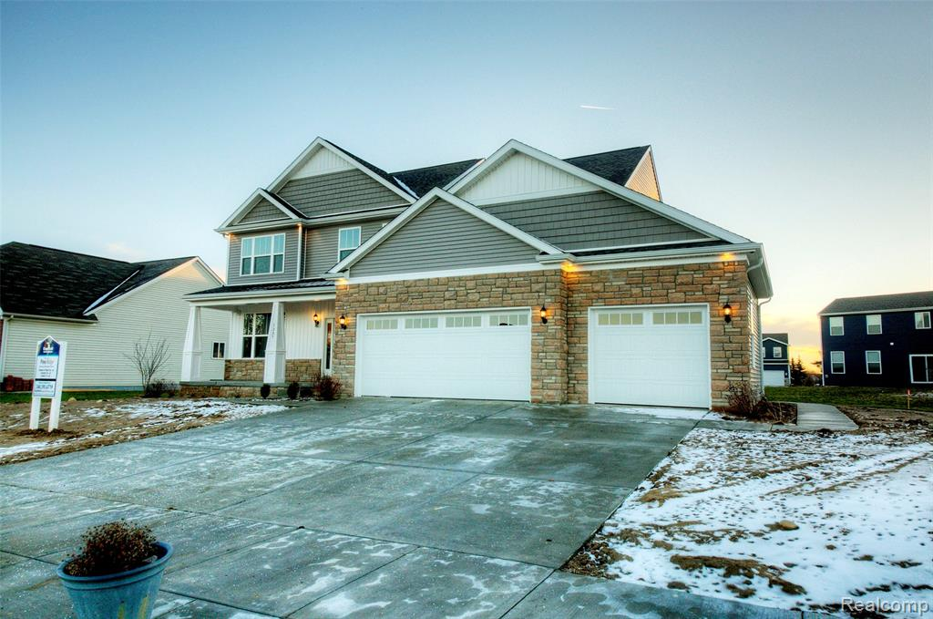 """Must have 3 car garage! Backs to woods- Walkout Basement. Open concept living and dining that boasts a state of the art kitchen with soft-close 42"""" Kitchen cabinets and quartz counter tops and 8' center island. Private master suite with a large walk-in closet, extended height quartz counter w/ dual under-mount sinks, Laminate flooring, premium carpet w/8'b pad,  9' first floor ceilings, Finished basement with 5th bedroom and full bath and Rec Room, 9' Superior basement walls with a  15-year structural warranty, energy efficient 96% Furnace and A/C, Gutters and Downspouts, Garage door openers, keyless entry, wireless access point and more. Includes landscaping with irrigation,1-year builder warranty. Amazing neighborhood with common areas, a future sports field and sidewalks throughout. Just minutes away from Historic Downtown Howell, restaurants, shopping and easy access to Highway I-96. Stock Photos. August 2021 completion.  Built by Capital Custom Homes."""