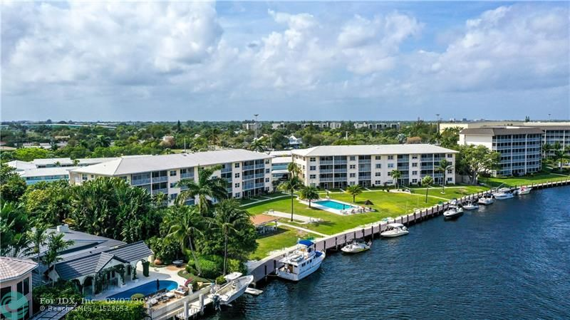 LOCATION!! LOCATION!! LOCATION!! Stunning Condo with Spectacular View of Hillsboro River and Royal Palm Yacht & Country Club. Features 2 bedrooms and 2 bathrooms Immaculate Fully Furnished and Completely Remodeled with Gorgeous Gourmet Kitchen. Screened Balcony Looking Over the Water. Close to Everything, I-95, Shopping Plaza's, Restaurants, Parks and much more!! 5 Minutes Away from the Beach!! If Your Looking For Private, Beachy, Tropical Scenery and Nightlife You Found Your Match!! Dock Space Available $2.50 Per Foot with Electric and Water Included. BOATERS DREAM!! INVESTORS WELCOME!! LOOK NO FURTHER THIS CONDO IS TURN-KEY AND A MUST SEE!!