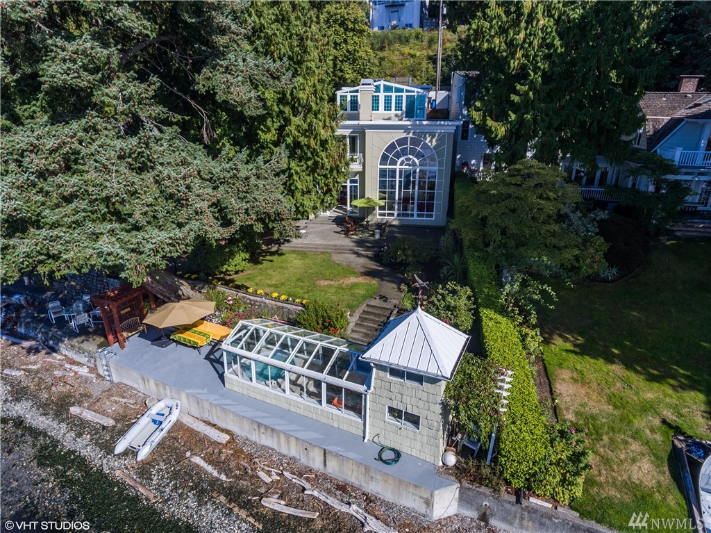 W Seattle Waterfront 3 bdrm/3.5 bth home, 3896 sq ft, 24,392 sq ft lot w/elevator & 2 car garage. Watch the lifestyle video of this incredible property. A Palladium window fills 22 ft high ceiling in the living room; perfect to watch sunsets. Rare property has gardens, large patios & a beach side cabana w/sleeping loft, ¾ bth & spa! Timeless design w/views of Olympic Mtns, cruising ships & pods of Orca. Saltwater lifestyle of paddle boards, kayaks & boats. Fishing & crabbing in your front yard!