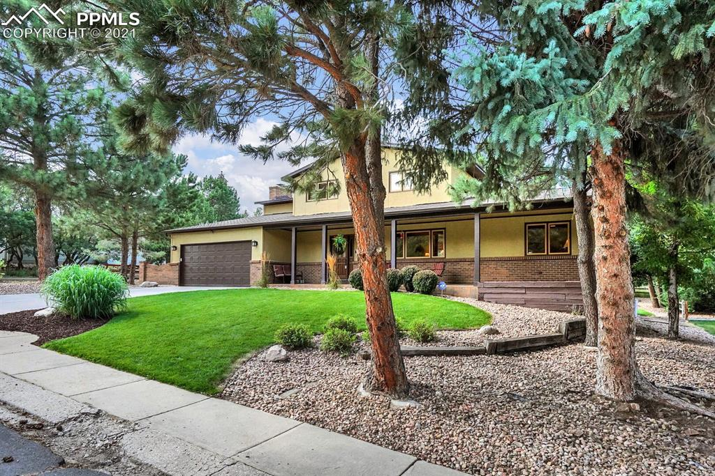 550 Big Valley Drive is close to everything you need yet nestled in a charming, wooded neighborhood with nature right out the door. This lovingly crafted, recently renovated home offers all the comforts you'd hope for. With 4 bedrooms, 3 baths and several living spaces, you've got room to spread out. There are multiple flex spaces to do with what you like; set up a home office, private fitness center, media room, workshop...you decide! Wood floors throughout the main level add to the charming craftsman touches you'll fall in love with.  Leaded glass door at the entry, stained glass chandelier covers, beautiful woodwork and more. Enjoy any one of the relaxed indoor spaces or step out to the beautifully maintained yard with oversized deck, built in seating and lush lawn. And not to be ignored, the covered front porch is the homeowners favorite spot to sit and watch the wildlife meander by. Other details of note: newer stainless steel appliances, granite slab countertops in the kitchen, marble tile backsplash, plush carpet in the bedrooms and built in storage in every closet. Basement has been beautifully built out to include hand textured walls, plush carpet, recessed lighting, and don't forget to check out the storage! Downstairs bathroom is roughed in and ready to be finished if you like.