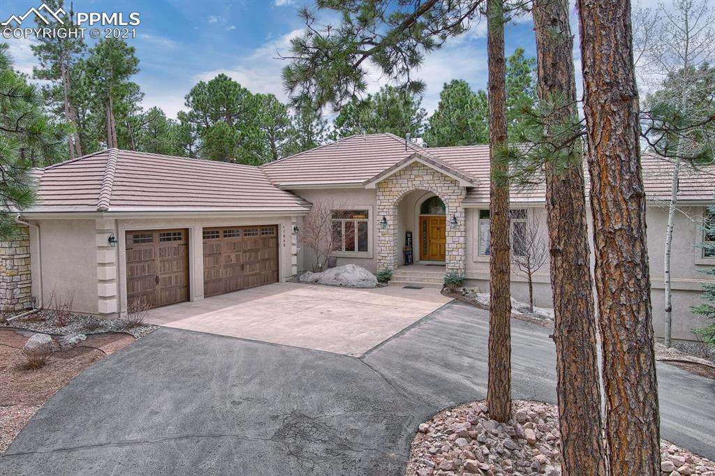 Welcome to this custom home poised on an elevated 2.5 acre lot in Higby Estates offering the perfect balance of Pikes Peak views and towering pine trees. Be greeted in the foyer that showcases a picture window framing the view of Pikes Peak. The great room boasts soaring ceilings, floor to ceiling stone fireplace, and a wall of windows. The renovated kitchen is beautifully appointed with a centerpiece island, quartz counters, stainless steel appliances, double ovens, beverage refrigerator, pantry, and dining nook. Enjoy entertaining in the elegant dining room featuring a coved ceiling with crown molding and built-in buffet. French doors lead to the main level study. Unwind in the master retreat with a dual sided gas fireplace, dressing area with custom built-in cabinetry, private deck, luxurious bathroom with heated floors, spa shower and walk-in closet. Even the Powder Room offers Pikes Peak views. The laundry provides a refrigerator and utility sink and leads to the fully finished garage. Descend the stunning curved staircase that opens to the sprawling walk-out lower level with sunny family room, gas fireplace, full wet bar, and wine closet. Four spacious bedrooms – one with adjoining bathroom, provide abundant space for family and guests. Host Movie Night in the tiered theater room. Take in the tranquility of the forest and views from the expansive deck or hike the neighborhood trail system. With easy access to I-25 and Hwy 83, you are conveniently located to downtown Colorado Springs and Denver, Lewis Palmer District 38 schools, shopping, and dining. This home features a renovated kitchen and master suite, updated lighting and ceiling fans, new interior paint, 2 newer furnaces and Smart Thermostat, new smoke detectors, new garage doors and openers, storage shed, gas stub-out on deck, electric wiring for hot tub, and much more. With the natural splendors of Pikes Peak views, towering trees, and privacy, this home reminds you of why you love to live in Colorado.