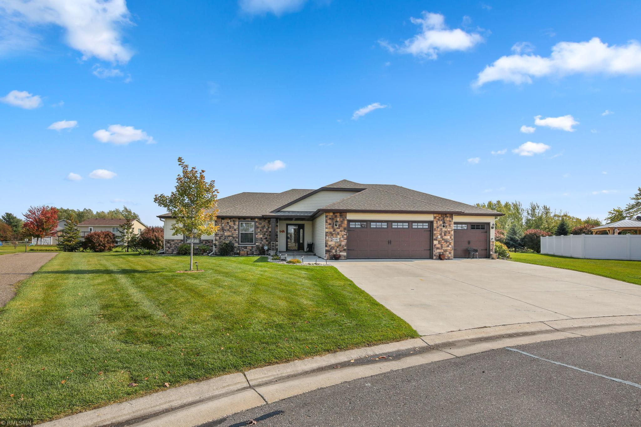 Welcome Home! This meticulously maintained, original owner, single level living home is what you have been waiting for. Upon entering this spacious home you will notice the open floor plan and beautiful gas stone fireplace. The kitchen features a walk in pantry, custom cabinets, tile backsplash, and upgraded appliances. The master suite offers a walk in closet, tray ceilings, large private master bathroom with a tile shower and heated floors. You will be sure to enjoy time spent out in the relaxing enclosed 3 season patio. The oversized heated 3 car garage provides plenty of space to store vehicles and toys. This gorgeous home has so much to offer, you have to see it for yourself, you will know this is the one!