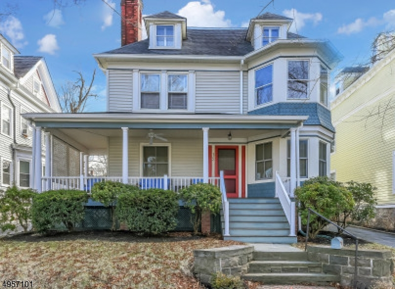 """Location .Just 2 1/2 short blocks to Town, A wrap- around  porch welcomes you to this beautiful Queen Anne Victorian home that has been updated thruout. Beautiful staircase with original stain glass window, 3 beautiful fireplaces (gas & wood burning) wood flrs, and gorgeous millwork.  The light filled, kitchen has a center island with breakfast bar,lots of Marvin windows, a door that opens to the beautiful yard with perennial gardens, stone patio and rock wall and retractable awning. The 1st floor consists of very large LR, banquet sized DR, kitchen, powder room. 4 bedrooms and bath make up the 2nd floor. The 5th BR is on the 3rd  floor with a full bath and a den. Newer detached garage, CAC, Marvin windows, updated heating, electric, & plumbing, make this home a must see. Home is in estate and sold """"as is"""""""