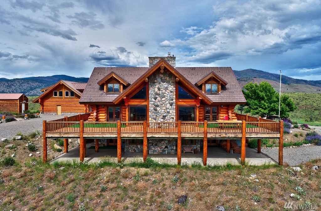 WINTHROP: Custom built Ark II Canadian log home, 5,000 sq. ft., dramatically poised above the Valley on 20 acres of rare magnitude. Spectacular views, Methow lifestyle, western grandeur, lodge style, 3 BDRMS, 4 BA, grand-great room w/ massive river-rock wood burning fireplace, granite floors, exquisite stone work, 3-suites w/ private bath, lower level for entertainment, detached 3-car garage + 1,400 sf ADU/studio above w/ 2 bathrooms, workshop/storage shed, low maintenance natural landscape.