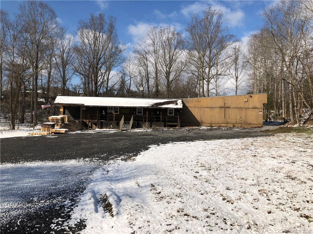 4600+ square feet (approximately) wooden structure with loading dock, front porch, restrooms, offices, warehouse, etc. on 1.4 level acres, open use zoning, behind KD's convenient store & GULF gas station, health food market/deli that border Scenic Highway 74A in the heart of Fairview. 9999 Tax amount TBD, 9999 year built is unknown. May be purchased with 7600 square foot metal building MLS 3644078 on 2.86 acres total for $875,000 MLS 3597595.