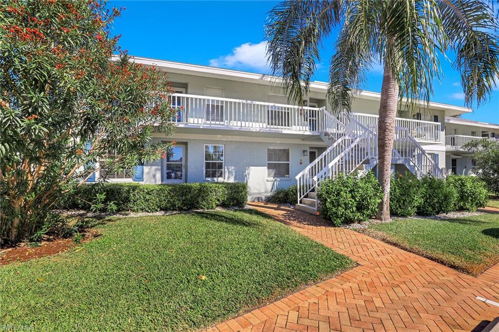 Lovely and well-maintained first floor unit with updated kitchen, bathrooms, stainless appliances, water heater, fans and fixtures in 2015. Granite counter-tops and breakfast bar. Spacious tiled lanai with laundry and extra storage area. Smokehouse Bay Club offers a great variety of amenities to owners that include tennis, pickleball, two pools, and a large Chickee Hut for social gatherings. The second pool is located at the amenity area on Smokehouse Bay and offers storage for your Kayak or paddle boat. Three association owned boat slips can be used on a first come, first serve basis. Close to the Esplanade where you can enjoy shopping and fine dining.  Start living the laid-back Island lifestyle you've been waiting for.