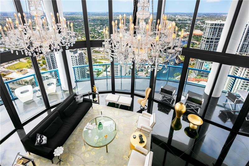 Epic 2 story PH in the heart of downtown at Las Olas River House. A rare haven of voluminous space & light boasting over 5,000 sqft, soaring ceilings of grand scale & floor to ceiling glass making for a superlative setting of sophisticated living, entertaining & art. Stunning unobstructed panoramic river views at any hour & dramatic sunsets over the sparkling skyline of Ft Lauderdale. Two private elevators open to the gallery-like foyer, a dramatic introduction to the extraordinary ambience that make this 3 or 4 bedroom home perfect for entertaining. Intelligently thought out, the 2story floor plan divides the residence between open spaces for gatherings & up the spiral staircase or private interior elevator, the 2nd floor is dedicated to personal privacy. The PH is a true urban refuge.