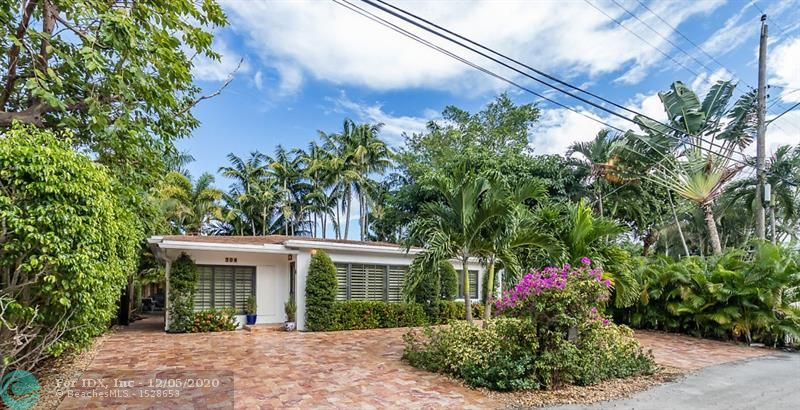This beautiful 3/2 has quintessential Victoria Park charm and is located on a quiet and private one-way street. Beautiful lush landscaping and patios w/ plenty of room for a pool! 2018 Impact windows/doors, 2018 AC, Water Heater 2018, Roof 2012 Authentic hand-dried Saltillo tile throughout all main living areas and bedrooms. SS appliances, pantry, granite countertops, floor to ceiling custom Carrera marble tile wall and backsplash, Separate dining room with large custom built-in glass cabinets; large custom built-in bar/buffet w/ solid white Calcutta quartz countertop, built-in wine rack, wine fridge & additional beverage fridge.Less than 2 miles to the Ocean, Walking distance to Galleria Mall, less than 1 mile to Las Olas Shops and Restaurants. Walk to Fort Lauderdale's Huge Holiday Park