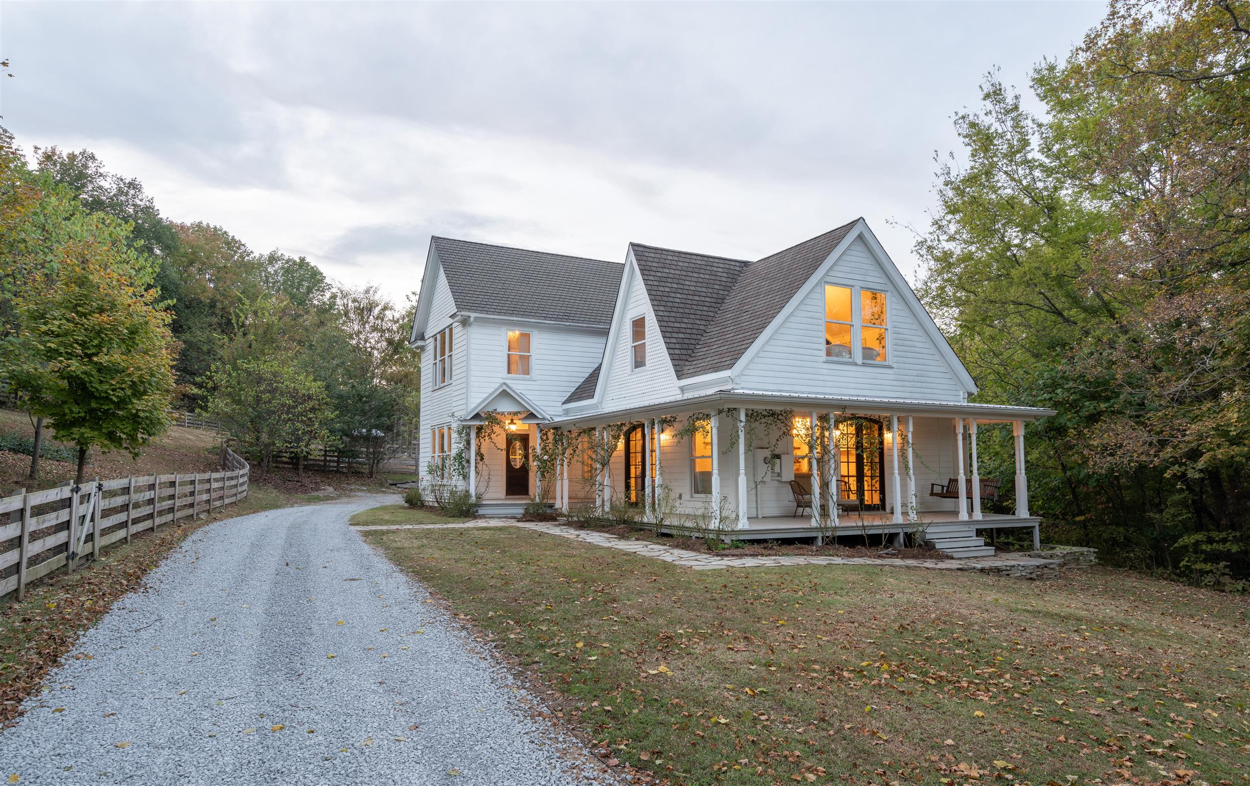 Dreamy Victorian Farmhouse in the hills of Tennessee with organic garden & land for your small herds. Owners purchased land & unfinished farmhouse open to the studs and built it out in 2014! This dream home and land features Wraparound porches, Antique Doors, Huge Gourmet Kitchen, Graze Pasteur and Open Meadows, Barn, Schoolhouse/Office, Tiny House   great for guests or Airbnb, Organic Garden with Garden Shed, Orchard full of various Fruit Trees, Rare Breed Chickens, Peacocks, Beehives and More!