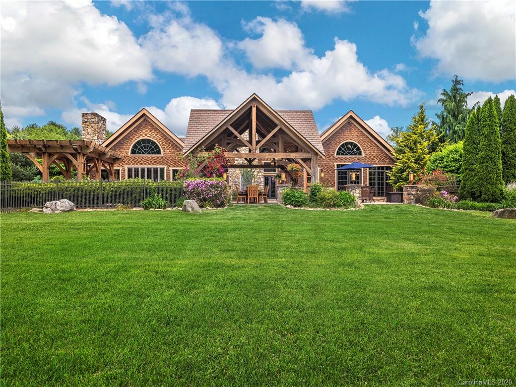 Rare opportunity to own a beautiful 15+ acre country estate minutes from Asheville. This exquisitely designed, post & beam timber frame home boasts almost 6000 sqft, breathtaking mountain views, & river frontage. Enjoy soaring ceilings, 4 stone fireplaces, & an expansive terrace. The gorgeous kitchen is a chef's dream w/all the luxury features. Watch a movie in the state-of-the art home theater, enjoy a beverage poolside, or go for a swim in the natural rock, solar-heated swimming pool w/ waterfall & beach entry. Pick apples in the orchard, go for a walk in the countryside or fly fish the hatchery-supported trout stream. Property includes a workshop, commercial grade internet, Tesla supercharger, & solar energy. Guests will love staying in the log cabin or apartment. If you want horses or farm animals, you'll appreciate the flat acreage w/ 7 fenced pastures & charming barn. Minutes from Chimney Rock, Blue Ridge Parkway, TIEC & Biltmore Estate. 32 AC Estate also listed at MLS 3662357.
