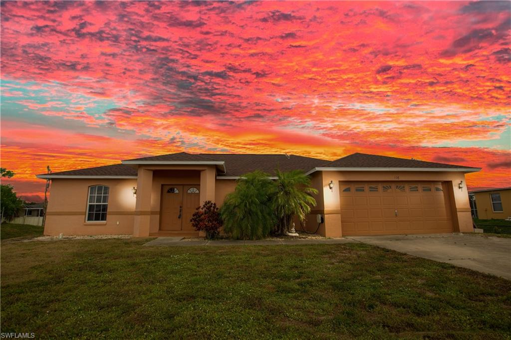 A favorite floor plan home in the highly desired community of Mirror Lakes is ready for new home owners! This home features 3 generous sized bedrooms plus den, large spacious open gathering room, 2 bath, & 2 car garage. Home is completely carpet-free with wood laminate flooring & tile throughout. Kitchen has attractive white cabinets & polished black granite for a beautiful contrast & a large kitchen island. Refrigerator was replaced last year. Off to the side of kitchen is a dining area & the hurricane impact resistant sliding glass pocket doors leading to the lanai & generous sized FENCED backyard with room for a pool! Home has new screening throughout. AC is just 3 years old & water heater was replaced this year and ROOF replaced 2017! Master bedroom, den and bathroom were just painted in popular neutral gray. Master bathroom was completely renovated with beautiful Zen feeling, frameless waterfall shower, bowl sink vanity all in soothing colors. Laundry room was renovated to add a wash basin and storage. Frigidaire Affinity washer/ dryer stay! Impact resistant windows throughout the home. CENTRAL WATER & SEWER, no expensive septic and well water. Make your offer today!