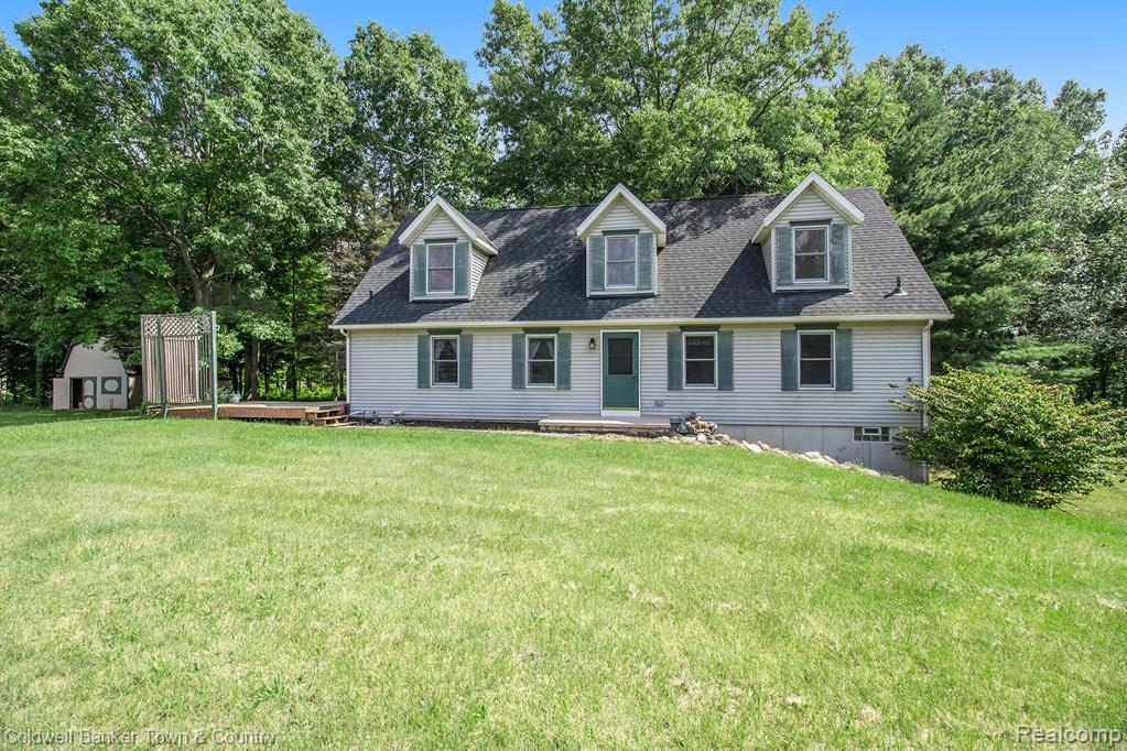Enjoy your 10 Acres of Country living ,just Minutes North of  Downtown Howell .This 4 Bedroom /2 Full Bath (with a roughed in 3rd Full Bath)This  Cape Cod will Fill the Hearts of a Family with many wonderful Memories. Featuring A Large Country Style Kitchen and Dining area /Large Tree Covered Deck /Daylight Walkout Basement/ 2 Outbuildings 16X16 Shed w loft & 24X40 Steel Bldg / Sport Shooters delight with Range & Safe / Roof Replaced 2018 / Furnace and Hot Water Tank 2014 / Newer Well Jet pump /Private rd with low Maintenance cost/   This a MUST SEE Property