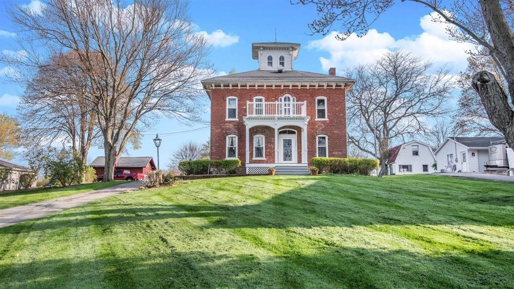 Summer fun begins here!  An opportunity of a lifetime!  Stately waterfront all-brick three-story historic Italianate architecture home, complete with Widow's Walk Lookout Tower/Cupola boasting a commanding view of all-sports Round Lake.  Originally built by physician William Towne in the 1840's, and the first house to be built on the lake, this home boasts 4 bedrooms, 2  baths with 3-car attached garage, and includes a Carriage House and pole barn on 1.4 acres with 120' frontage and dock on Round Lake.  Over 170 years of charm and historical character, combined with dozens of upgrades and updates in the last 20 years, make this the perfect year-round residence or weekend getaway!  Move right in...home is completely furnished, including kitchenware, bed linens, entertainment system and more...ready for immediate turn-key occupancy!  The Carriage House is a perfect extended-family residence and sleeps 4 comfortably, year-round.  30x40 pole barn with large doors will house all your waterc