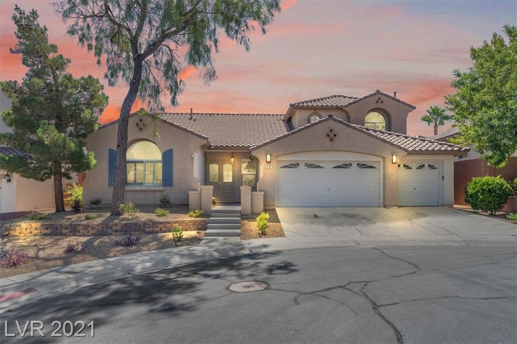 Freshly painted LUXURY Summerlin style home in gated community on cul-de-sac! PRISTINE living at its finest with stunning chef style kitchen, finished backyard to include POOL/SPA and 3-car garage!!!!! Step inside this spacious home and allow her to lead you through all the additional space you've been looking for. The grand staircase and high vaulted ceilings will WOW you as you pass through the double door entryway. The 2 living spaces PLUS formal dining area are accented by the ample amounts of natural light from the large windows. The HUGE master bedroom features a massive walk-in closet and more! This one is truly turnkey and ready for its next owner. MUST SEE TODAY she won't last long!!!