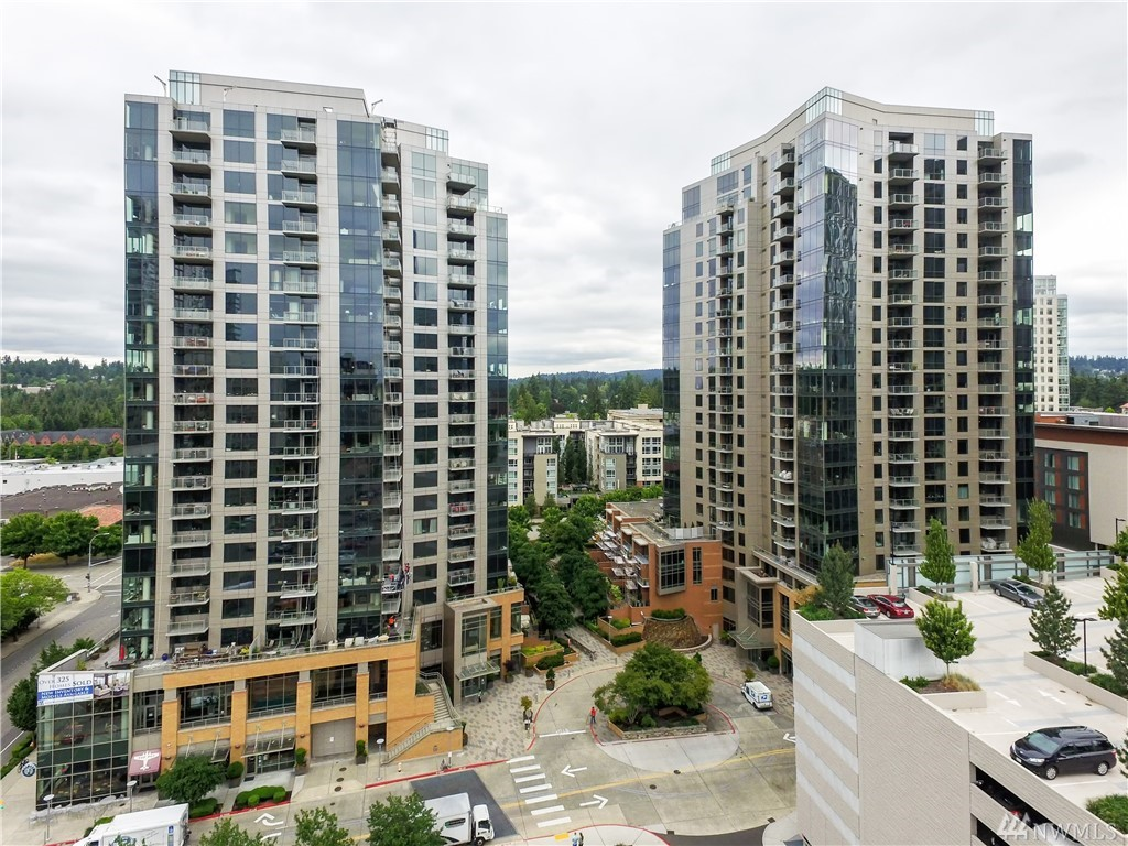 Exquisite 1 bedroom + den in Bellevue at luxurious WA SQ. Situated on the 18th floor, life is elevated! Grand & spaciously featuring a chef's kitchen, high-end SS appliances, slab countertops, gas cooktop & fireplace. Splendid master bedroom w/marbled ensuite, built-in CA closet, plus adjoins patio terrace. New carpeting, AC, roller shades, and fresh paint.  Sweeping sights of Cascade Mnts, Spring District, Bell Square, Msft, Amazon, and East Link Light Rail. Merely moments to I-90, I-405, 520.