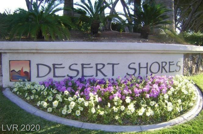 Upgraded 1st floor condo with tile and wood floors, window coverings, designer lights and bathroom fixtures and stainless appliances in the kitchen with granite counters. The community is in Desert Shores with lakes and beach club. Community has a pool and spa and more!