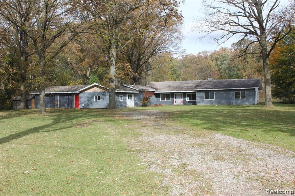 HUD Home. Much Larger than it looks from the street. Large master suite with a walk in closet and almost 7 acres of privacy!