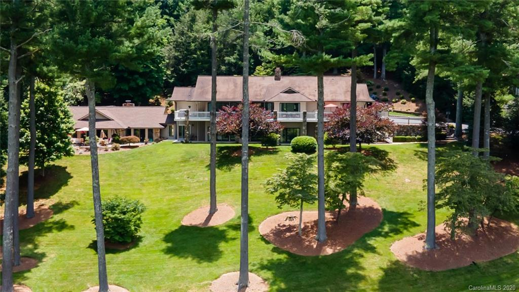 Fabulous Lifestyle Home situated on 1.25 beautiful landscaped private acres showcasing majestic mountain and golf course views. This prime location is one of the few homes located on the prestigious Kenmure Golf Course with close access to gate & amenities. Main level features hardwood floors, high and vaulted ceilings, an array of windows that bring the outside in and enhance the panoramic views, 2 master suites on main level, living room w/ fireplace, spacious kitchen w/ high end amenities, granite, walk-in pantry, breakfast area, dining room, laundry room and powder bath. Lower level boasts family room w/ fireplace, bar area, 2 guest suites plus add'l room, studio/office and access to pool house. Experience outdoor and resort-style living at its finest- fantastic pool house featuring heated pool, multiple sitting areas, stone fireplace, mini kitchen, hot tub, sauna and dressing area w/ bath. Multiple deck areas, stone patios, covered front porch and private picnic area. Spectacular!
