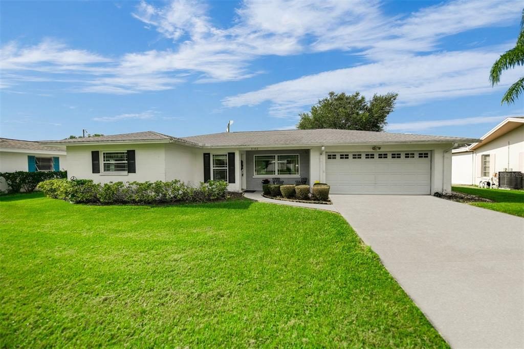 Welcome to Gulf Gate! This is your opportunity to own a 3 bedroom, 2 bathrooms, 2 car garage home with water views and nearly 2,000 sq ft under air. This home has a great split-plan layout, open kitchen, tile floors in nearly every room, a massive interior laundry room, and a lanai overlooking the water. The Florida room is huge and you can watch the wildlife on the pond through your impact windows. It has everything you need to live an amazing life in paradise. Gulf Gate is conveniently located near dining, shopping, fitness centers, legacy trail, library, and minutes from World Famous Siesta Key Beach. New AC and backflow (2020), electric panel (2013), and roof (2007). Come put your finishing touches on this home today!