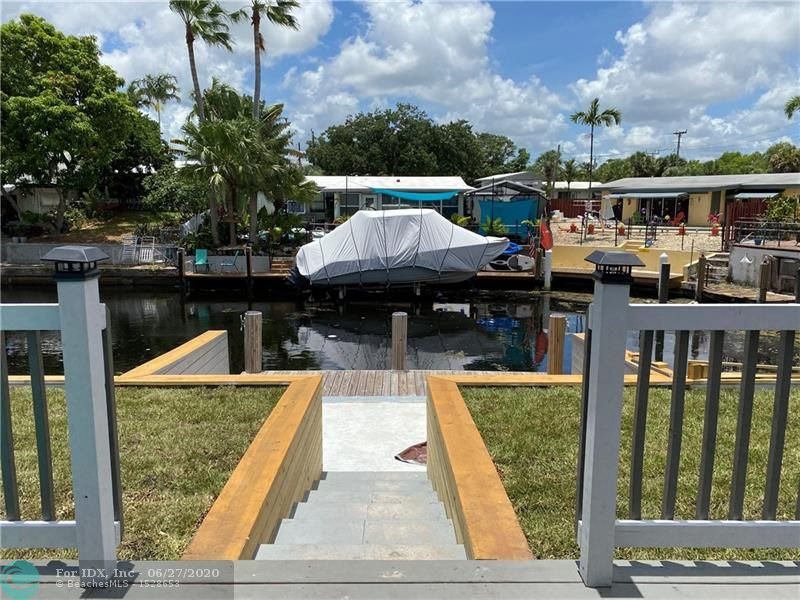 WATERFRONT WITH NEW DOCK; NEW: ROOF, 100 AMP ELECTRIC, HURRICANE IMPACT DOORS, GUEST BATH, SEWER LINES/WATER MAIN PVC, KITCHEN, LIGHTING, GUTTERS, SOFFITS, TOILET IN MASTER, CEILINGS, BACK DECK, SPRINKLER, PLANTERS AND LANDSCAPE. NEWER A/C