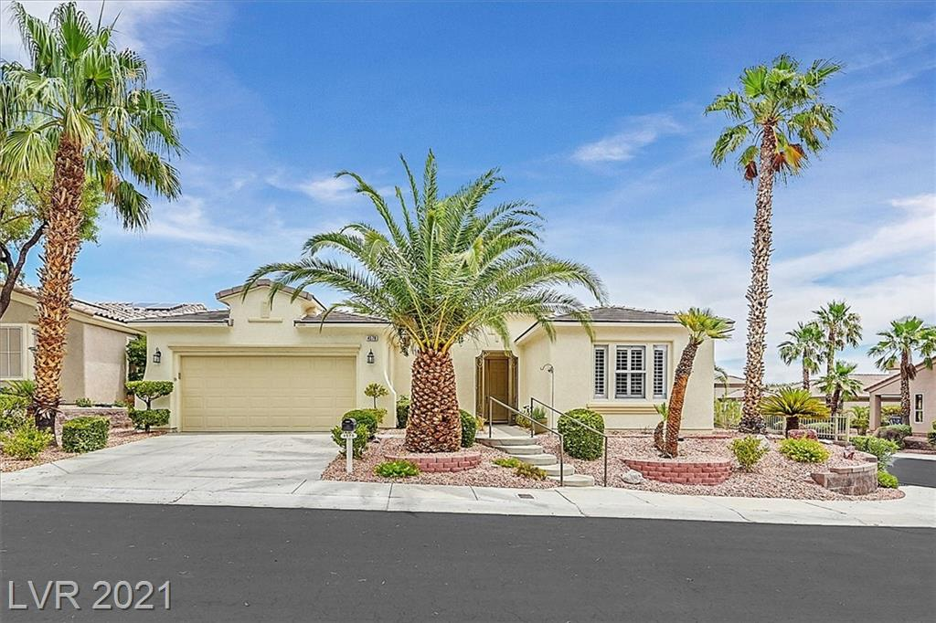 Looking for a move in ready single story home in a spectacular 55+ golf course community in Summerlin? This is it! This beautiful home has 2 bedrooms plus den (optional 3rd bedroom), open floor plan and plenty of windows for natural light.   Kitchen is combined with the family room and flows into the living room. Den has custom built in cabinets/shelves with undermount lighting.  Primary bedroom closet has been expanded and built out with extra drawers, hanging space and shoe cubbies.  House is situated on a large, elevated corner lot at the entrance to a cul de sac. The backyard has a covered patio that looks out towards the Strip with a view above the surrounding homes. Conveniently located near the clubhouse and the main entrance off of Town Center, you may easily walk to the amenities and enjoy all Siena has to offer.  Seller is motivated!  The house is a terrific value. Take a look!