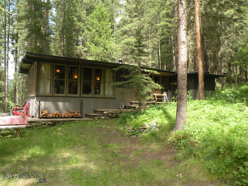 Escape from it all. Charming fully furnished Forest Service Cabin surrounded by Forest Service land, wildlife and solitude, is sighted on .5 acre site, 8 +/- years remaining on the easily renewable lease. Recently installed septic system, seasonal cistern like water system from Tamphrey Creek, and the always reliable outside half bath (no plumbing necessary) allows for a wonderful experience. 2 bedroom, an inside bath, and heating all make this cabin a perfect get away. Certain usage restrictions do apply, but if this was an inholding parcel the value would be .. well you can imagine. Enjoy the best.