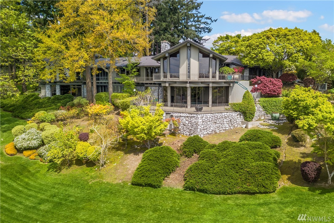 Stunningly maintained, once-in-a-lifetime piece of Laurelhurst history. Private manicured estate will take your breath away. The irreplaceable construction and detail are a work of art. Main level features a private master wing that evokes tranquility of a five-star spa. Living areas spill out to sprawling patios. Wine cellar, indoor pool/spa and sauna. Property includes private gate and turn around driveway. Beach Club rights. See MLS for vacant parcel directly to the south listed for sale.
