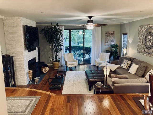 Just minutes from NYC, this contemporary ranch-style townhome offers private living in a prestigious 24 hour gated community.  Enjoy a lap of luxury in this rare Phase II end unit with extra windows that illuminate the home with natural lighting. Features include: Brazilian teak hardwood flooring throughout and grey strand bamboo in the bedrooms, large sunken living room with a wood-burning fireplace encased in a white stone facade, private patio with custom insulated drapes, formal dining room, granite countertops, state-of-the-art French door, touchscreen Smart refrigerator with sound system,  remote-controlled electric fireplace in the Master bedroom, California closets, heated bathroom floor, separate deep soaking tub plus walk-in shower, innovative new washer and dryer, and attached 2 car tandem garage.