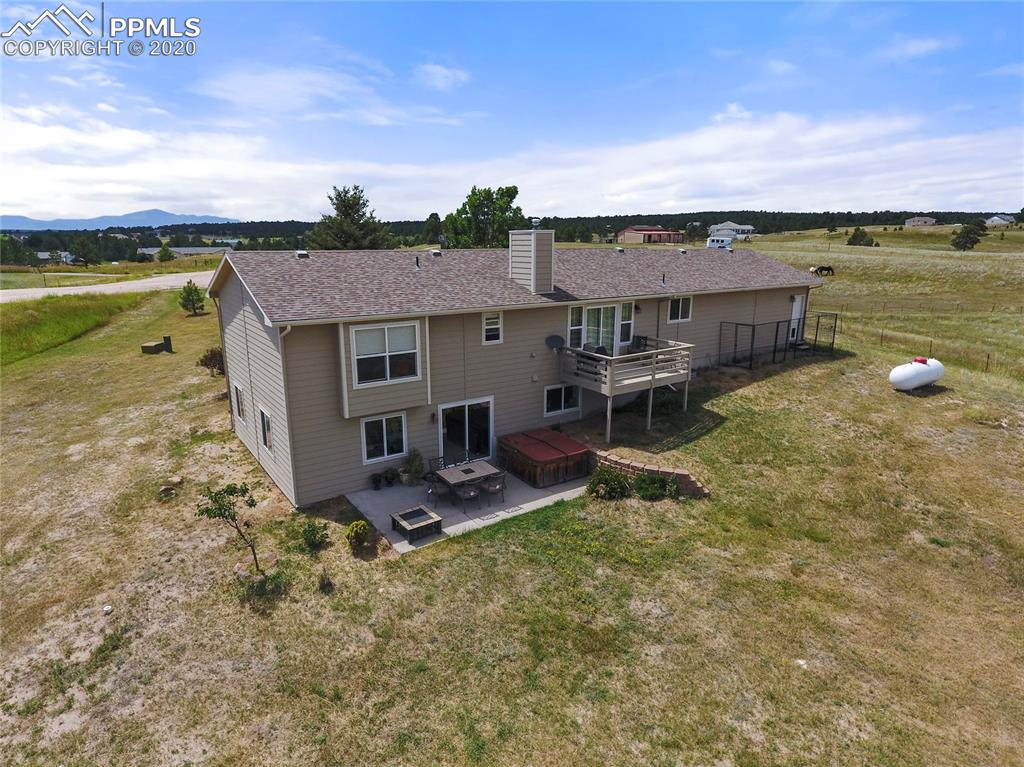 Almost 20 acres on a quiet cul-de-sac w/ a meticulously maintained rancher in Black Forest w/ exceptional Pikes Peak views, a walk-out basement and a 40x40 barn! The home is open and bright w/ tons of large windows for natural light. Great room with gas log fireplace, vaulted ceilings, walk-out to the back deck. Open kitchen with an abundance of cabinets, hardwood floors, pantry, granite counters, new stainless steel appliances including a double oven, recessed lighting and breakfast bar.