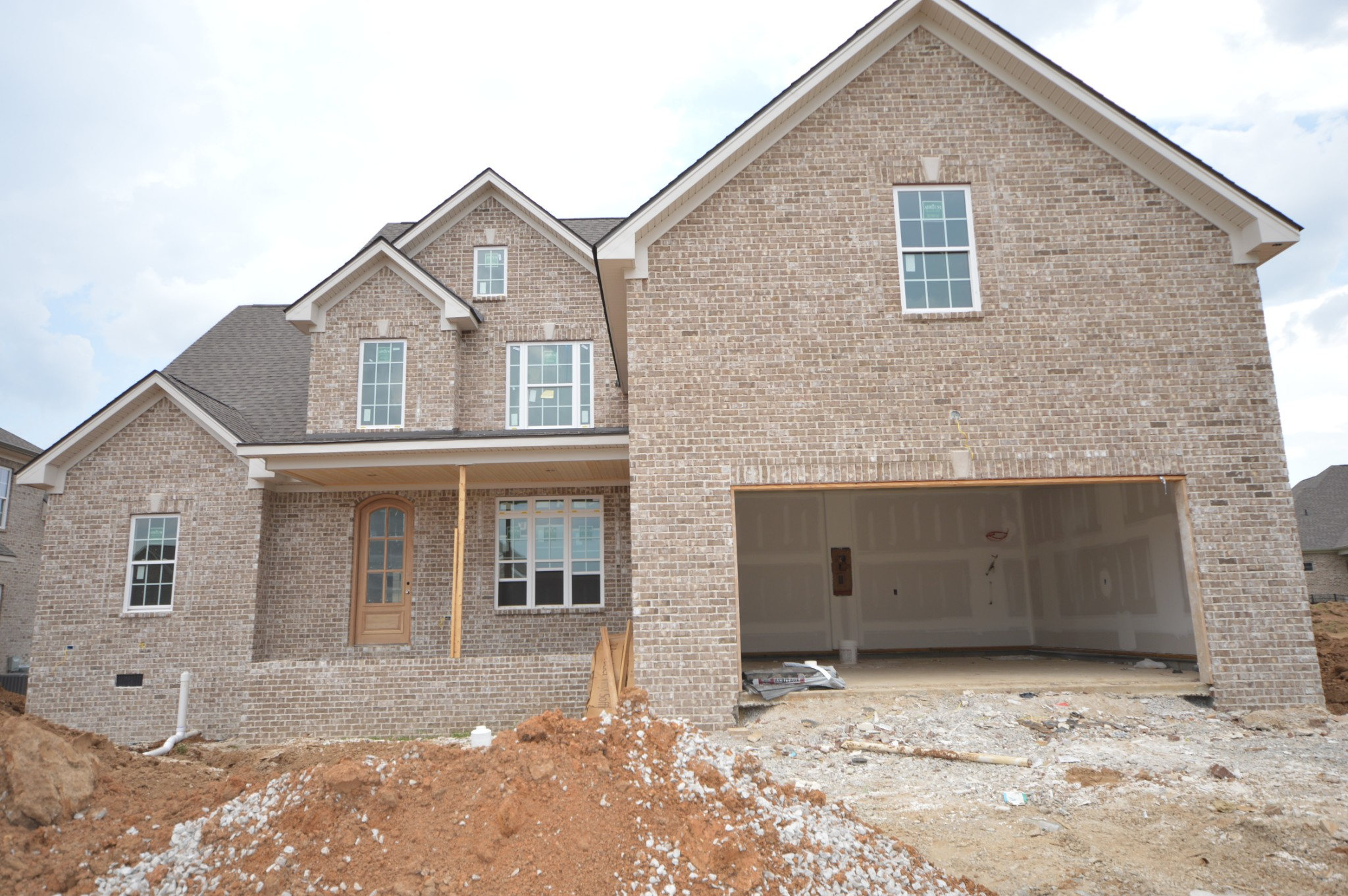 RG Custom Homes. Large Covered Front  & Back Porch! Two Bedrooms Down, Granite Throughout, All Wet Areas are Tiled, Tile Surrounds In Secondary Bathrooms, Sand and Finish Hardwoods, Gorgeous Trim Work, Custom Kitchen Cabinets,