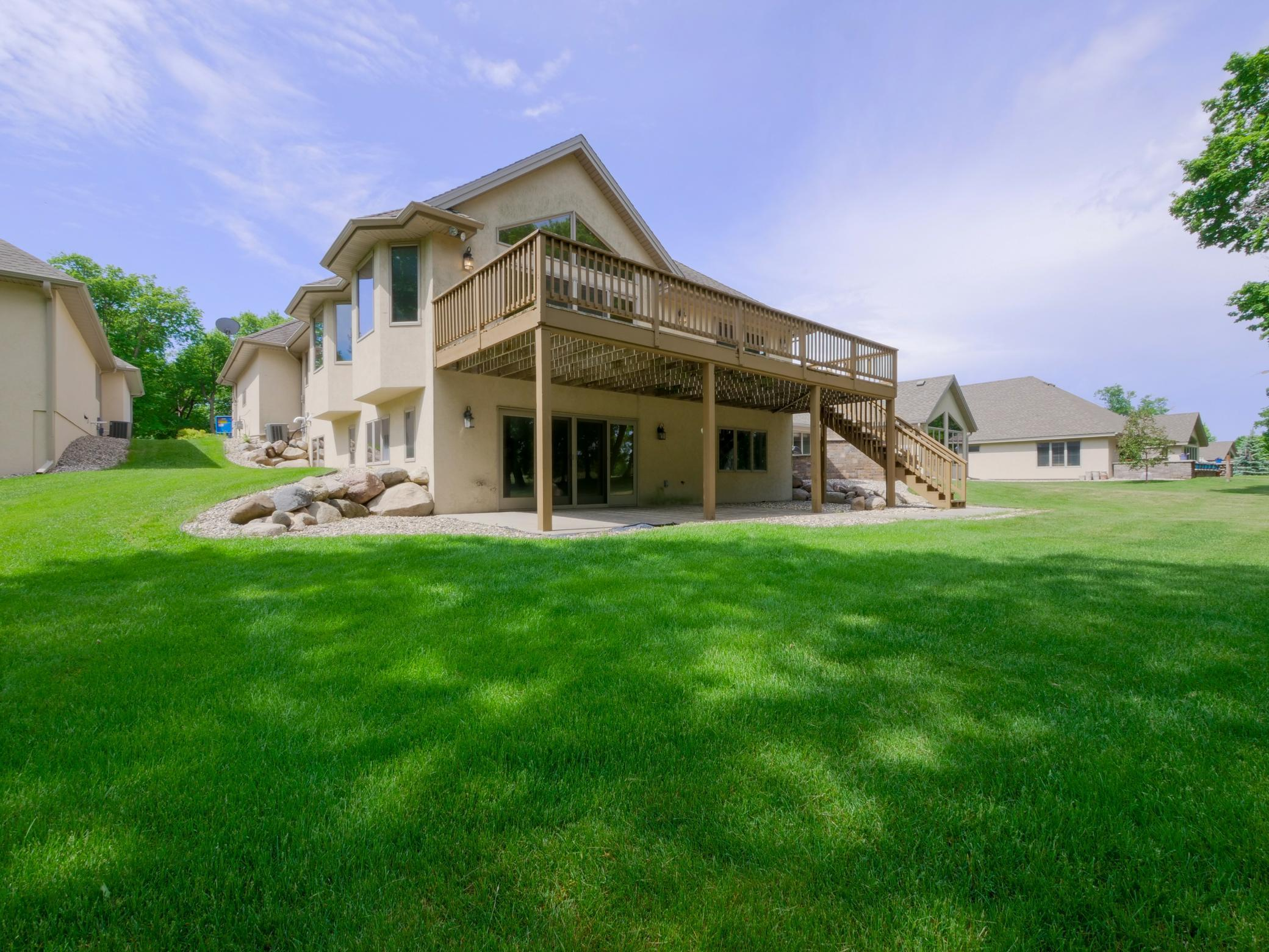 Rare opportunity to get a home on Lake Geneva Golf Course at this great price! This large rambler with walk-out basement sits on one of the prettiest lots on the Golf Course! The 36x12 deck overlooks the fairway of hole 5-great!Large master suite with gas fireplace opens onto deck.  4 bedrooms, 3 baths plus office and large family room with wetbar- opens onto the patio. There's so much potential- just needs some paint, flooring, love and attention! Enjoy living in this great neighborhood for a steal! Lawncare, snow removal, well water, in-ground sprinkler system all taken care for you by the association. Plus the best assn pool in town with 2 bathrooms, showers, and patio furniture all taken care of and yours to use! Any age can buy here-no restrictions! Golfer's mecca! Famous Lake Geneva Golf Course is a 27 hole Championship Course with driving range, Restaurant, and professional golf academy! You couldn't build this 2920 Sq Ft home for this price anywhere let alone on this fab spot!
