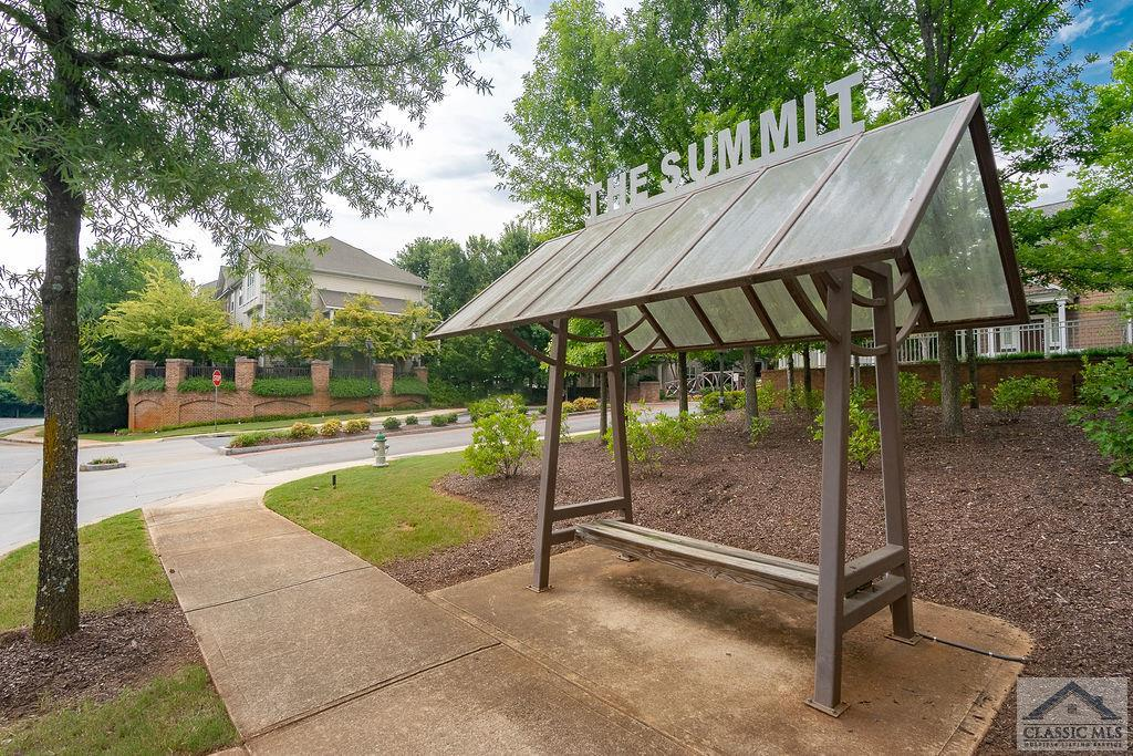 Sought after gated student community close to UGA, restaurants, shopping and more. Come inside to laminate wood floors, open floor plan, bar to kitchen, stove, microwave, refrigerator, washer and dryer. Half bath for guests downstairs and the living room has built-ins for your books or collectables. Upstairs you have 2 bedrooms with vaulted ceilings, both with a en-suite bath and large closets. Clubhouse with business center, pool tables, fitness center, pool, and tennis courts.