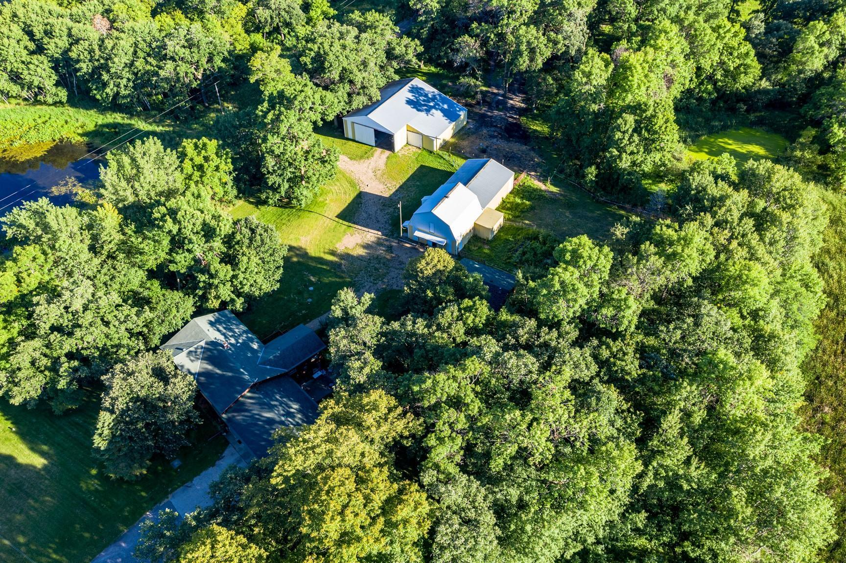 See supplement for complete details. Too much for print here. Hobby farm all set up for horses.  5-6 stalls in barn.  Approx. 8 acres tillable pasture, 2 wooded and 2 with buildings.  All pasture acres with electric fencing.  Many upgrades in home.  Barn 36x30 with attached 40x30 pole building.  Extra 60x40 bldg with 40x20 lean.  A must see for any horse lover!