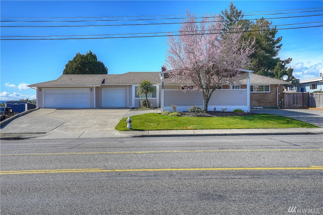 You'll be captured by the view walking in the door!  Western exposure allows you to see sunsets, the Bay & Olympics from your living room, kitchen, deck & Pool house.   2 separate, up/down living areas w/ fireplaces, Central Air, & 50yr roof.  Updated kitchen w/custom cabinets & lots of storage. Beautiful granite & Porcelain tile throughout.   Circular driveway w/ Portico makes pulling onto Jackson a breeze.  Lot's of parking.  Start planning your BBQ now!