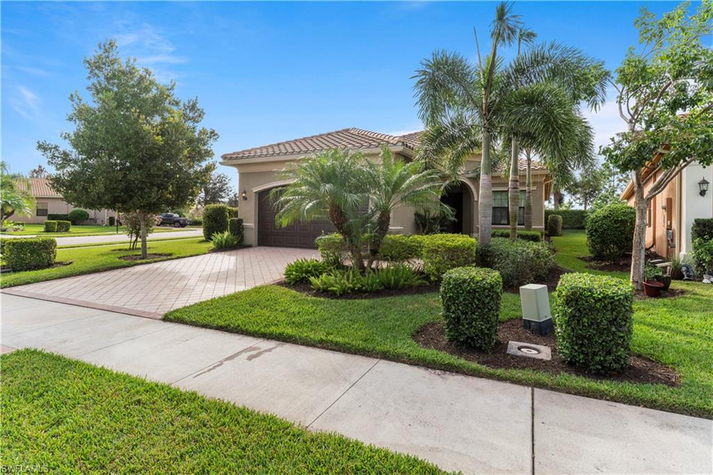 This lovely three bedroom plus den home is located in Riverstone. The open floor plan invites you in and features a dining room big enough to seat all of your guests! The kitchen has stainless steel appliances, granite counter tops, pantry and a nice large island to eat your breakfast. The great room overlooks the screened in lanai with your very own in ground, saltwater system pool and spa. All bedrooms feature walk in closets and the master has elegant tray ceilings.  The master bath has a large soaking tub, separate shower and dual sinks. The home also has  central vacuum system and a 2 car garage with sink and plenty of shelving for storage. Riverstone offers Five Lighted Tennis Courts, Indoor Basketball/ Pickleball Court, and Outdoor Basketball Courts, State Of The Art Fitness Center, Resort-Style Pool, Lap Pool, Relaxing Whirlpool Children's Water Play Area & Wading Pool, Open Play Area, Arts and Crafts Room/ Aerobics Room, Game Room, Social Room With A Catering Kitchen,Covered Party Pavilion and a Full-Time Lifestyle Director.