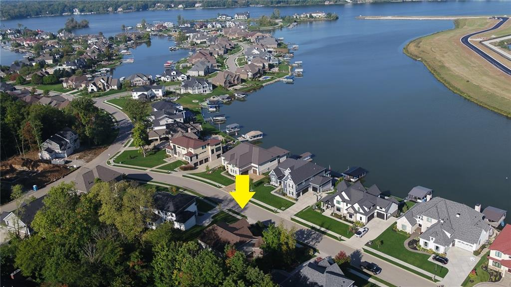 This Remarkable 5BD Home in Cambridge w/Views of GEIST Lake is Phenomenal---Open Layout with detailed moldings & trim throughout.  Main Level Features Beautiful Hardwoods, Solarium w/ 12'Coffered Ceiling, Lg. Formal Dining RM, Executive Office, Great RM w/Floor-To-Ceiling Windows & Built-In's. The WOW Factor is the Kitchen-Massive Area w/Lg. Center Island, Cook-Top, Dbl Oven, Plentiful Cabinet & Counter Space & Breakfast Area. Master w/Inset Tray Ceiling, En-suite w/Walk-In Shower, TWO Walk-In Closets AND 13x12 Sitting Area! Secondary BD's & 2ND Office on Upper Level. Daylight Basement w/ Family RM, Rec Area, Wet Bar, Lg. Unfinished Area for Storage & Possible 6th BD or Fitness RM. Fenced In Rear, Irrigation System & Private Outdoor Patio.