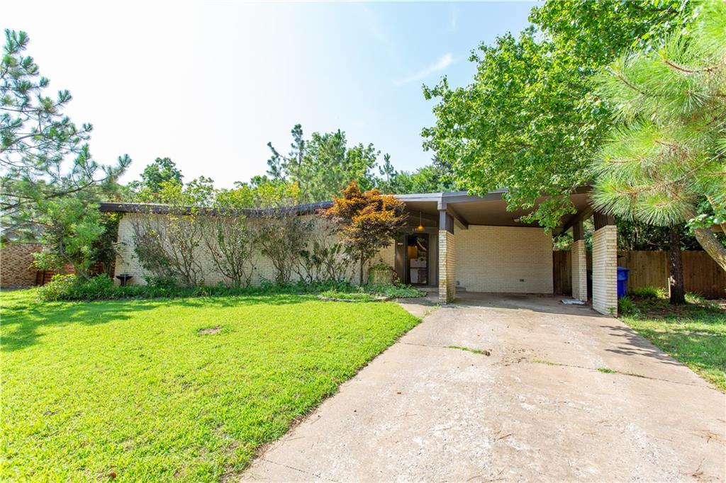 Mid-Century Modern DREAM! An actual time capsule.  Located conveniently between HWY9 and Lindsey St, less than 2 miles to campus. Upon entering, you will see beamed high ceilings leading you past the kitchen and into the sunken living room with beautiful builtins and a fireplace. Property has serene landscaping with mature trees and a shady back yard.