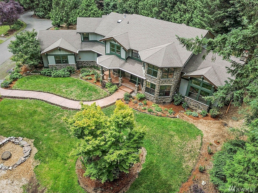 This Elegant Estate sits on an acre of private land, just minutes to Redmond town or WA-520. If you are tired of busy life and want to taste luxury living, come and experience all it has to offer – privacy, exceptional details, custom architectural design, intricate millwork. You will always find something to do here, whether it's reading in your private library loft, soaking in your elegant tub, hosting game parties in your great room, having friends for a BBQ, gardening - options are endless.