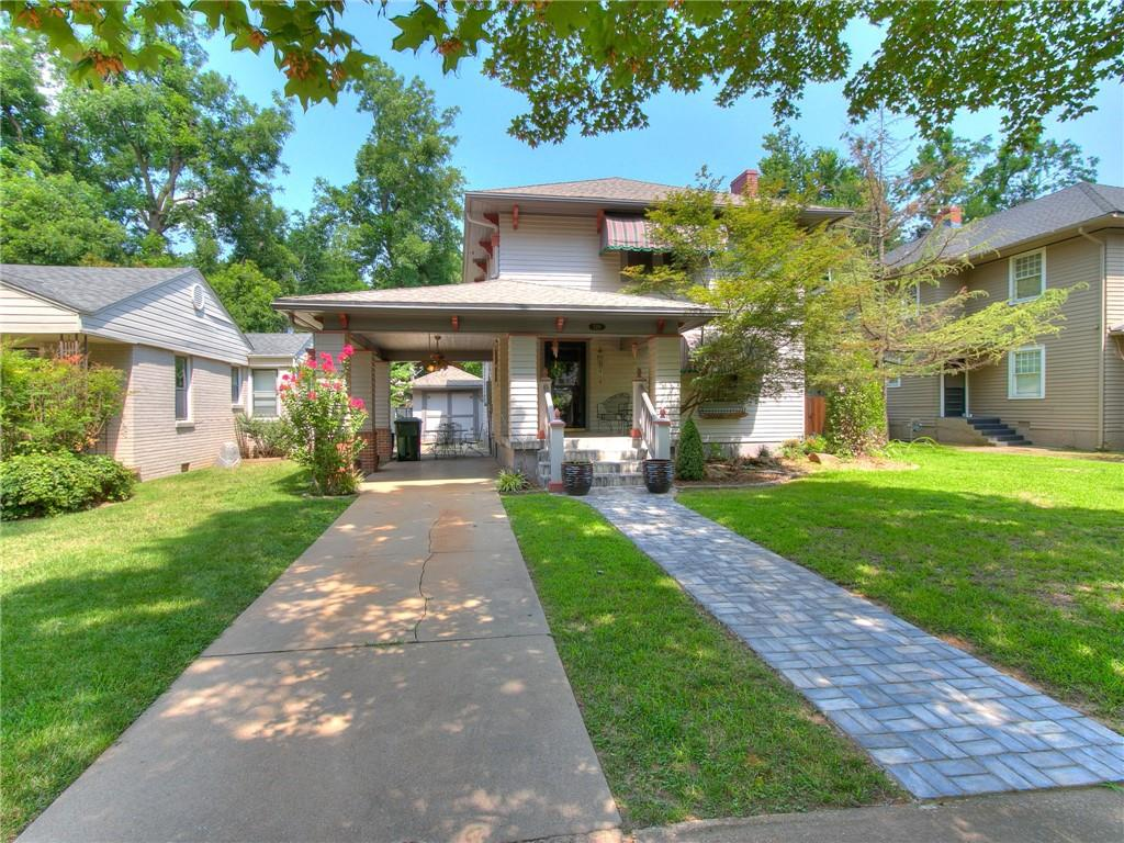 Location. Location. Location. This adorable Craftsman home is a true gem in the Chautauqua Historic District.