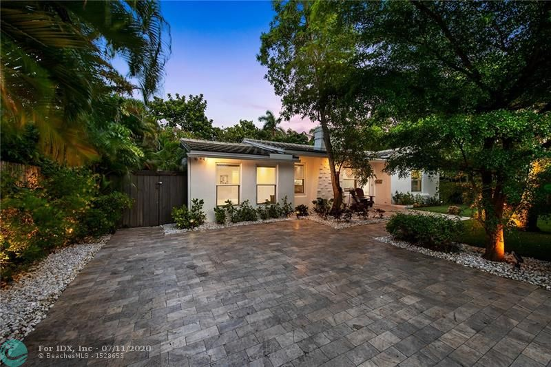 Magazine-quality 4BR/3BA whole-house renovation in 2014 in the heart of Victoria Park is the best South Florida has to offer.  Just steps away from Holiday Park, and walking distance to shops and dining - this house is an absolute oasis.  The open concept kitchen features quartz countertops, custom cabinetry, a wet bar and an incredible view of the back yard with tons of light.  Throw the French doors open and enjoy the over-sized heated, salt-water pool and ample back yard with covered patio and out door shower!  This mid-Century gem offers a triple split floor plan with beautiful hardwood floors and modern basins / fixtures. Impact windows & doors throughout make hurricane season a breeze!  *Appraisal says 1,858 sq feet* Easy to show! Please look at the 3-d virtual tour!