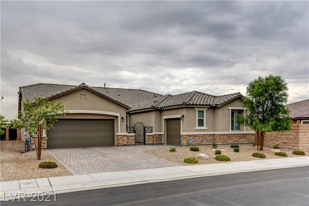 This extraordinary single story home was recently built by Richmond American in 2019 and is located in the highly desirable, gated, Breccia Bay community. It features an abundance of custom upgrades and shows just like a model home! It is rare to find a house this new, complete with a gorgeous new swimming pool and waterfall! When entering the home from the courtyard and into the foyer, you will immediately be impressed by every fine detail; including luxury flooring, custom window shutters, and elegant lighting fixtures. The stunning gourmet Kitchen, includes stainless steel appliances, double ovens, wood cabinets, quartz countertops and a large center island for entertaining. The breezeway to the formal dining room is a unique feature, offering even more space and elegance. This dream home is 2,536 sq. ft. with 4 bedrooms and a 3rd car garage. Every aspect of this home exudes quality craftsmanship and luxury. Located near great dining, shopping and all amenities! See this home today!