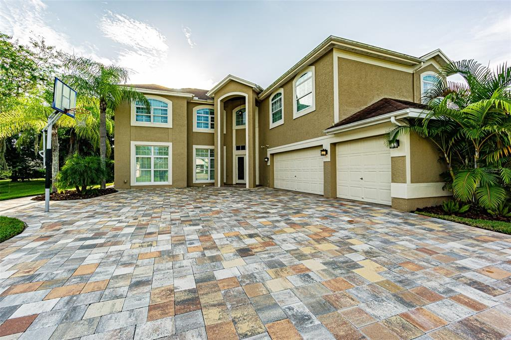 Enjoy the luxury of this grand home located in Calusa Trace. This state-of the-art home has 6 bedrooms, 4.5 bathrooms, and an office, 3,650 sq.ft., and 3-car garage.  A meticulously beautiful paver's driveway leads to a beautiful landscape, and to the grand entrance featuring a glass double door. Enter a magnificent grand foyer with a gorgeous wrought iron rail, marble and wood staircase.  Upstairs you find the bedrooms, with a luxury master bedroom with a luxurious bathroom with granite countertops, marble floors, and wood window shutters, French doors lead from the master bedroom and bedroom 4 to an extraordinary screened enclosed balcony overlooking the pool area. The other bedrooms are hardwood floors, and the bathrooms are marble with granite countertops as well.  You can walk the house on your own, just give in the following link: https://my.matterport.com/show/?m=y8Y4zxzuyNe  You'll want to spend all your days lounging around your beautiful, brick pavers area screened pool, covered lanai, and summer kitchen.   The focal point of the home is the gourmet kitchen. Beautiful custom wood cabinets with every attention to detail, granite counters, and state-of the-art appliances. It is truly a dream kitchen!     Conveniently located near expressway and shopping area.  Do not miss the opportunity to own this luxury mansion.