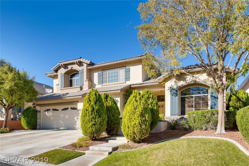 Fantastic Pool Home in Beautiful Woodlands Neighborhood in Summerlin / Back yard paradise with Covered patio / Pool & Spa and Firepit / 3 Car Garage / Upgraded Flooring / 1 Bedroom and Full bathroom downstairs plus a Den/Office and 4 Bedrooms upstairs /