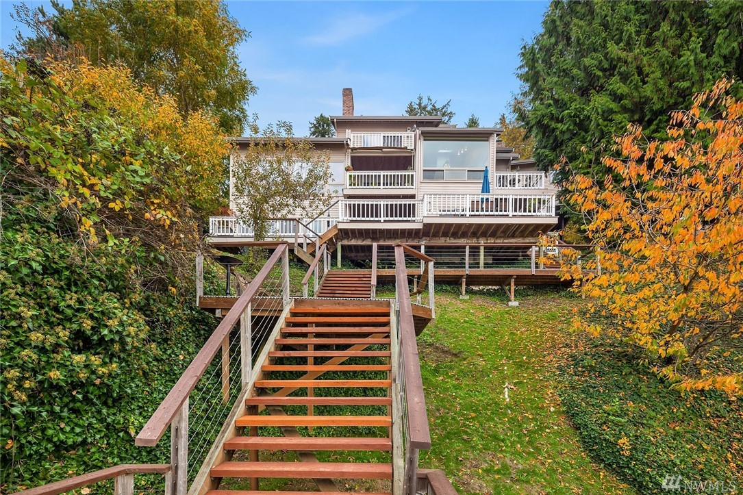 Stunning western Lake Washington views and waterfront too!  The perfect combination with 89 feet of Lake Washington frontage with a dock.  This custom built home has soaring ceilings in the living room, a luxurious master suite which is a lovely retreat and a spacious chef's kitchen that adjoins the family room.  The home is oriented to provide expansive views from almost all rooms. The lower level features a media/rec and 3 additional bedrooms. Extensive decks for entertaining. 3 car garage.
