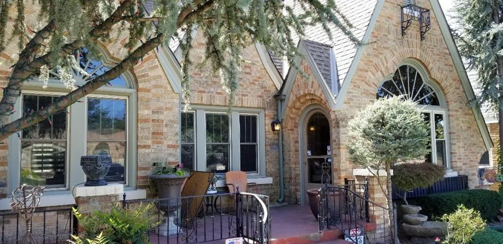 Located in a highly sought after Historical Neighborhood, this beautiful, highly cared for and much loved Linwood Tudor boasts Original Architectural features such as Trefoil Arched Windows, maintained Hardwoods throughout, Original built in study, Period Perfect Chandeliers, beautiful Mouldings and Doors with Original Glass Doorknobs- just the kind of place you would love to come home to! This home has an exceptional layout- with an Optional 4th bedroom / guest room on main floor. Laundry hookups located up stairs! Serious Storage throughout both floors including walk in closets with built in drawers and shelves. You will find a Cedar closet too! What a lovely neighborhood lined with mature trees, beautifully cared for yards, and wide open porches waiting with treats for those bustling Trick-or-Treaters! Just a short walk to the neighborhood park with close access to the Plaza, Uptown, Midtown, and Downtown. You'll love all this home and neighborhood has to offer!