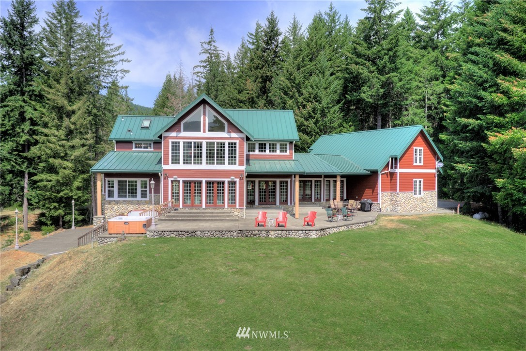 Incredible home now available in Packwood WA. Stunning views of the Cowlitz river and valley. Successful vacation rental. Less than 30 minutes to White Pass skiing & Mt Rainier Natl Park. 2 1/2 hours to SEA & PDX. 3 bedrooms + bonus sleeping room. 5 total bathrooms. Finish work of highest quality. Hardie plank exterior with river rock and cedar trim. Very private and surrounded by park-like pasture, towering trees and wildlife. Large, 3-bay, heated garage with approximately 530sqft of unfinished space above. Expansive aggregate patios on main and lower levels for outside entertaining. House sits on a knoll high above the river with views on all levels. 50 amp RV hook-up. Both exterior/interior were repainted this year.  3D tour available.