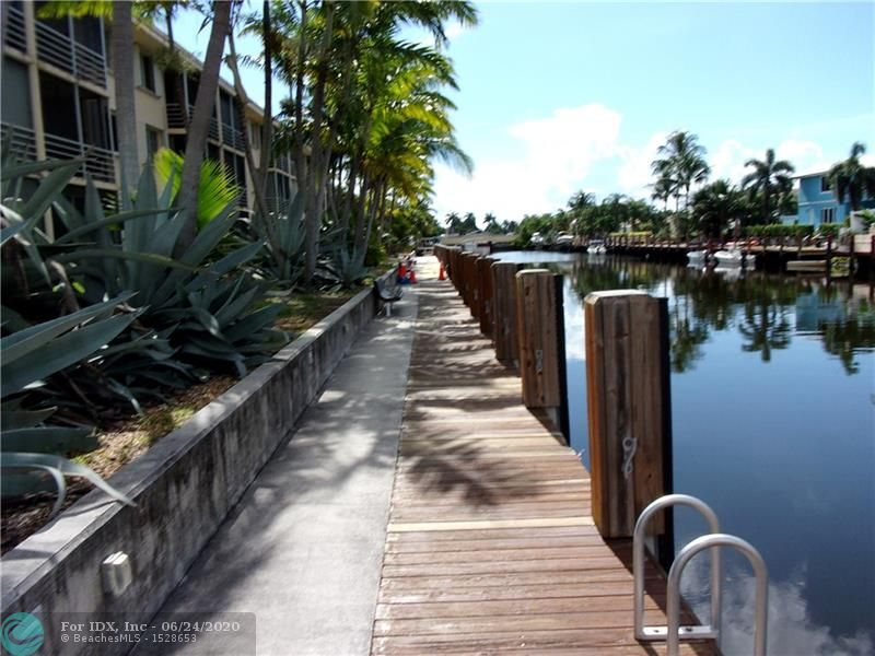 Beautiful 2 Bedroom 2 Bathroom condo on waterfront with boat docks and with access to the intracoastal and beyond. This condo is great value for the price and will not last long on the market. The community has boat dockage. The second bedroom has a Murphy wall bed for space saving and convenience. Walking distance to restaurants and shopping. Complex includes 2 clubhouses, gym, extra storage, pool, barbeque, shuffleboard, billiards and picnic area.