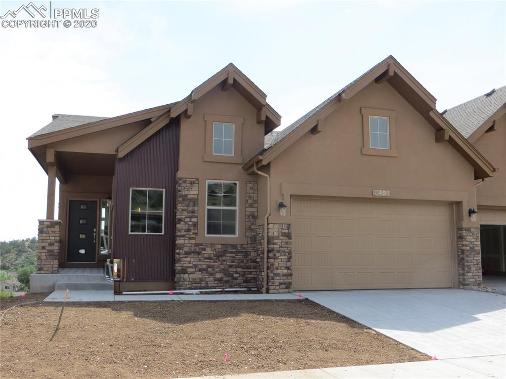 Welcome Home to the Eagle Lake a ranch plan in a Colorado Elevation! The Heart of the Home, is a Chef's dream with granite slab counters, stainless, steel appliances, staggered cabinets, pantry, and a large island providing additional seating is centrally located and entertains well. Relax in your Great room in front of the gas fireplace. The Dining area walks out to your deck with views of Ute Park. The Master Suite is accompanied with a plush 4-piece Master Bathroom and large walk-in closet. A second bedroom/study, full